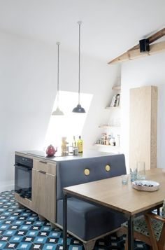 I'm not a fan of the materials they used here, but the design is really clever and fresh for a small kitchen
