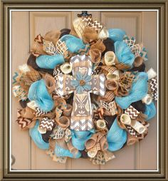 Very trendy turquoise & chocolate brown cross wreath!  Order through CheckeredDaisy on Etsy  $94.99