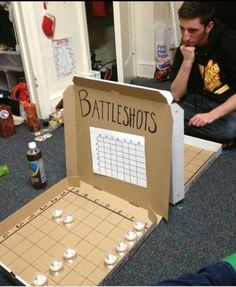 Battleshots for college kids...might just have to play this with mt. dew or sunnyD. :D Or we could just eat a super rich chocolaty treat or marshmellows. first person unable to eat the marshmellows loses :D