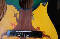 Woodland animals painted guitar.