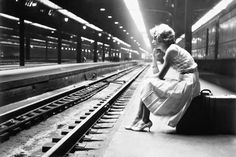 Teenage girl waiting for a train in Chicago, 1960.