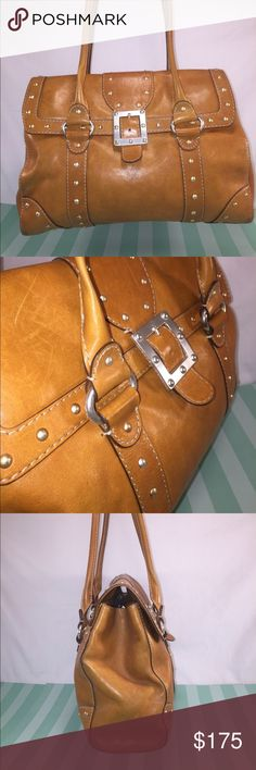 MICHAEL KORS Tan Leather Satchel MICHAEL KORS Tan Leather Satchel w/brass &silver tone hardware. Exterior back has large slip pocket w/magnetic snap closure. Front flap has magnetic snap closure. Interior has 3 main storage sections: 1w/ zip top closure, &2 close w/ flap top. 4 slip pockets ,1zipper pocket,&1 keyleash. Very nice preowned condition w/ light wear: scratches to leather (looks appropriate on this style &most were there originally). Wear to base front corners &straps but still in…
