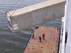 Loading containers via pontoon in Turbo, Colombia (too dangerous to dock alongside the shore)