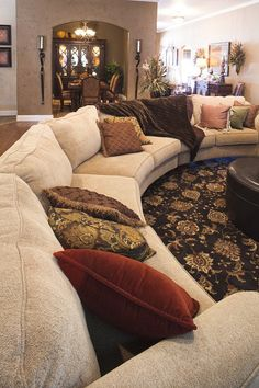 Betenbough Homes Lubbock Model Home - Living Room with large sectional sofa couch