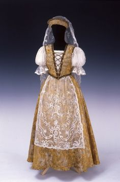 Gold-brocaded silk velvet dress with lace apron and veil, by Gizi Hajdú R., Hungarian, ca. 1940.