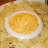 Chicken Wing Dip: 2-8 oz pkg cream cheese, softened , 1 c Marzetti's Blue Cheese Dressing or Ranch Dressing, 3/4 c pepper sauce [Tabasco] 2 1/2 c diced cooked chicken, 1 c shredded Mozzarella/Cheddar cheese *Preheat  oven 350 (175 degrees C). *In 13x9 in casserole dish, spread the cream cheese on the bottom & spoon the blue cheese dressing on top. Mix hot pepper sauce with the chicken until well blended & spoon on top of blue cheese. Sprinkle with mozzarella & bake 30 min.
