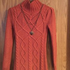 "Burnt Orange Sweater dress. Sz xs I'm sz 2. NWOT Another purchase bought and never wore. It's super cute and extremely warm. It's a burnt orange color. It's an size xs. I'm 5'9"" size 2 too give you a size reference to go by. Questions please ask. Sweaters Cowl & Turtlenecks"