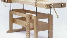 Erpelding's commissioned workbench offers limitless versatility.  The worktop is raised and lowered via a crank system that is made up of threaded rods in the legs connected to a chain underneath the benchtop.