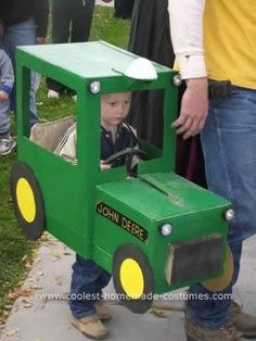Homemade John Deere Costume: Our son HAD to be a Tractor for Halloween. So, Dad went to work even getting real working lights from the local hardware store so we could see him in the Wagon Halloween Costumes, Halloween Costume Contest, Boy Costumes, Car Costume, Animal Costumes, Halloween Games, Halloween Projects, Costume Ideas, Games For Kids