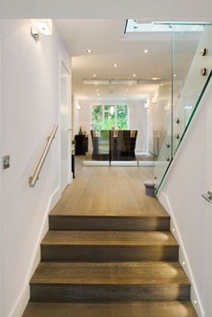 Beautiful wood flooring and stairs with side lights
