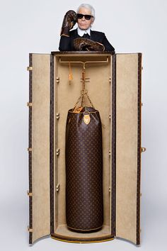 "In celebration of Louis Vuitton's iconic Monogram canvas, Karl Lagerfeld imagined an extravagant set of luggage and accessories for devotees of the ""sweet science."" His Boxing Trunk is fitted with a signature punching bag and stand, while. Karl Lagerfeld, Marca Louis Vuitton, Louis Vuitton Monogram, Kick Boxing, Boxing Gym, Boxing Workout, Lv Handbags, Louis Vuitton Handbags, Louis Vuitton Luggage Set"