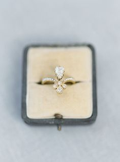 Eccentric fleur de lis-esque engagement ring: http://www.stylemepretty.com/little-black-book-blog/2015/12/04/charming-french-estate-wedding-inspiration/ | Photography: Jake and Heather - http://jakeandheatherphoto.com/