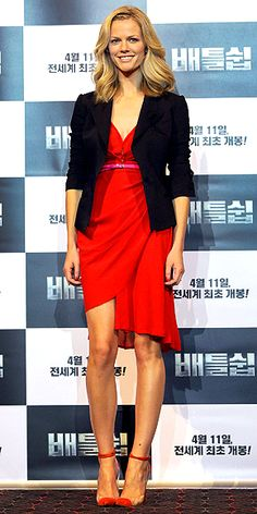 BROOKLYN DECKER  The Battleship beauty attends a Seoul press conference in a flirty cherry-red dress, shrunken black blazer and Lucite-and-red cap-toe pumps.