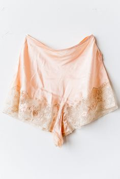 """- Overview - Care - Shipping - DESCRIPTION: 1920s peach embroidered floral inset on lace. CONDITION: Great-Excellent. New old stock. MEASUREMENTS: Waist: 30"""" Hips: 48"""" Fits-Like Estimate: M/L - To pro"""