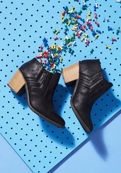 Embrace the originality of your cool style with these vegan faux-leather booties! Redefining the idea of edgy appearances, you push boundaries with every step of the top-stitched chevron inserts, layered heels, and urban-chic cut of these unique beauties. Get it, girl!By the way, this lovely item will be available in July!