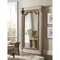 Versatile and accommodating, this unique floor mirror presents a wonderful traditional addition to your home. The piece features a mirror that opens up to a felt-lined back panel with jewelry bags, hooks, holders and two dividers. Completed with a dual Caramel Froth and Paris Vintage finish, this piece fits well in formal bedroom settings.