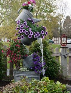 Watering can fountain.... love this!!  Make your own~all the pieces are available at American Home & Garden in Ventura CA Looks too hard for my skill level.