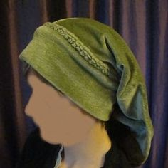 Follow the step by step instructions of how to make a Medieval Snood a hat for ladies that hid their hair and also kept their heads warm. T...