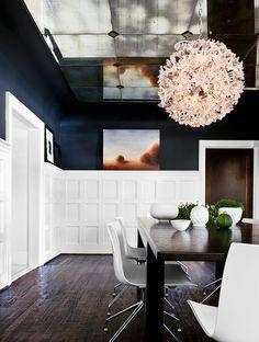 White wainscoting, Navy walls, Mirrored Ceiling, Dark wood floors, Modern furniture, Space age chandelier sphere. dining-room