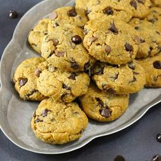 Gluten free chocolate chip peanut butter cookies are slightly crispy on the outside, but soft and gooey, and filled with chocolate chips.