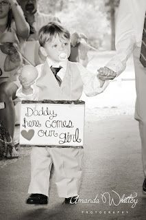 """Daddy here comes our girl"" sign. Proceeding his mommy down the aisle at the wedding. So sweet"