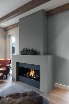 The sort of look for the fireplace that we're thinking of for the living room. We would I think have a Stuv or sth similar. Wooden Fireplace, Home Fireplace, Fireplace Inserts, Living Room With Fireplace, Fireplace Surrounds, Fireplace Design, Living Room Decor, Fireplaces, Living Rooms