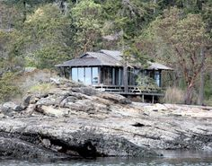 """""""A short boat ride from Fulford Harbour, the house is reminiscent of a Japanese teahouse on its rocky perch"""""""