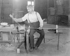 Salvador Ysart in the Gaffers Chair finishing a Monart vase shape GC.  Probably 1920's or 1930's.