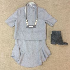 WEBSTA @ effiesinc - Let's get nice and cozy with this adorable two piece set. Our #Lookoftheday is a grey felt top with matching grey felt ruffle skirt, @hearne_dry_goods_co necklace, and a grey suede bootie! Come by today