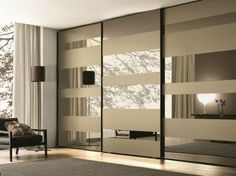 mirrored wardrobe doors mirrored glass wardrobe with sliding doors mixed with grey carpet on laminated floor with mirrored sliding closet doors for bedrooms also closets with doors bifold mirrored war Mirrored Wardrobe Doors, Modern Closet Doors, Interior Closet Doors, Bedroom Closet Doors, Mirror Closet Doors, Modern Sliding Doors, Wardrobe Design Bedroom, Sliding Closet Doors, Wooden Wardrobe