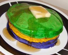 Got Fat Tuesday? :) Mardi Gras-themed pancakes! Just add food coloring to your favorite pancake recipe(divide it into 3 bowls to mix a color per bowl)