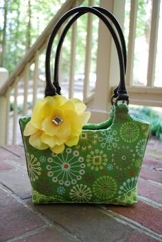 Take a cheap bag from Goodwill and  a little Mod Podge you can turn it into a beauty of a handbag.