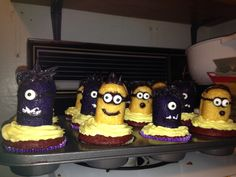 "Minions and evil purple minion cupcakes!! They're made out of Twinkies. The purple minions are ""spray painted"" using purple color mist. Try cotton candy for the hair :)"