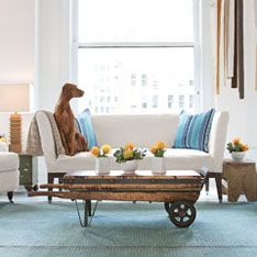 Sunbrella: Inspiration - A Dog's Life -- Love the modern interpretation of country style! Old painted wood, industrial casters, and repurposed items   along with that fabulous art installation create a room with amazing visual interest. J'adore!