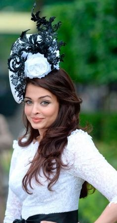 Aishwarya Rai wearing a Philip Treacy hat at Royal Ascot 2013.