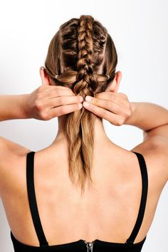"Gym-To-Work Hair That Looks AMAZING #refinery29  http://www.refinery29.com/workout-hairstyles-by-texture#slide-14  First, section your hair into three parts. ""Start each section at the arch of your eyebrow, and then just draw it back,"" Redway says. The middle section will be slightly larger than the side ones. Pull the side sections into ponytails at the tops of the ears, and then Dutch-braid the middle section. Once you get to the level where your two ponytails are, incorporate them into…"