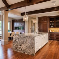Each piece of Bianco Antico Granite is unique because of the variations in the composition of the granite. This incredible island takes breath away!  Design by Design Build Duluth  #biancoantico #biancoanticogranite #graniteisland #naturalstone #granite #granitekitchen #kitchenisland #kitchencountertop #asenseofplace #kitchendesign #kitchendecor #graniteideas #kitchenideas #kitchenstyle #kitchenlove #kitchenlover #interiorjunkie #interioraddict #kitchendesignideas #kitchendecor…