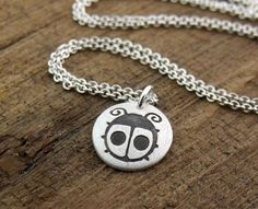 I love lady birds, they are my favourite animal / insect. Silver type metal pendant.