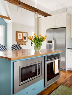 A second oven, along with a microwave, in this kitchen island comes in particularly handy when entertaining.