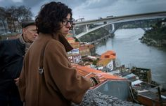 Portugal Beckons Tourists With Sun, History And ... Slums  Portuguese architect Margarida Castro (right) provides a tour of  Porto in 2014. She is one of three unemployed architects who set up Worst Tours to show visitors the poverty in the city, which has been hard hit by the country's weak economy in recent years.