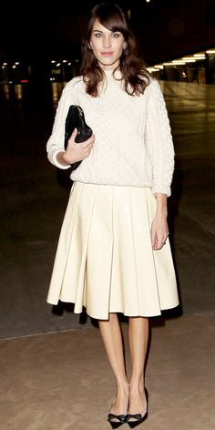 Alexa Chung took in the J.W. Anderson collection at London Fashion Week in oversized studs, a cozy knit, pleated skirt, leather clutch and bowed kitten heels.
