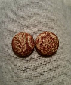 • Fine and Dandelion button earrings    •Handmade fabric button earrings featuring a gold and orange floral pattern.    •Post style earrings