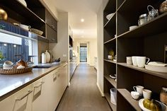 butlers pantry: Direct link to Kitchen itself, being more user friendly. Also the butlers has a external window versus typical internal space.