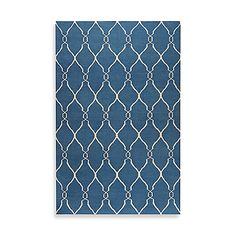 This blue and ivory Afton Rug is highlighted by simplicity and sophistication. The hand woven flat weave construction features a fresh and fun pattern that will coordinate with any decor.