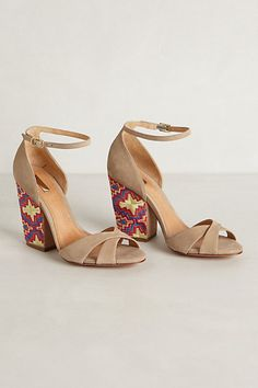 obsessed with these nude ankle strap suede sandals with brightly colored embroidery on the block heels
