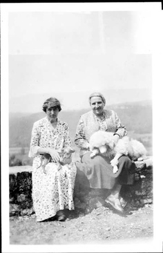Alice B. Toklas and Gertrude Stein with the poodle, Basket in Bilignin, France. They spent many summers in Bilignin, and doted on Basket whose successor, Basket II, comforted Alice in the years after Gertrude's death.