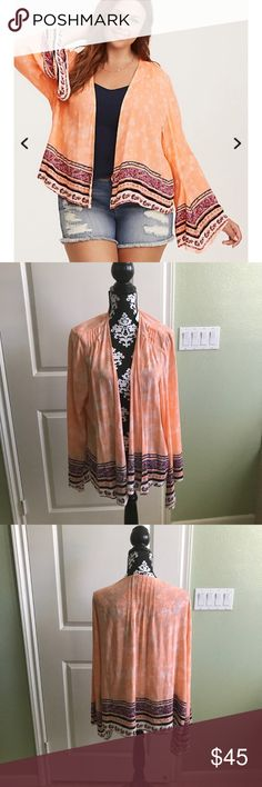 """Torrid Border Print Gauze Kimono NWT The sherbet gauze on this kimono is primed for a catching a breeze, with a subtle white tie dye pattern splotched all over. A multi-color, """"picked this up on vacation"""" inspired border print lines the slightly bell sleeves and draped front.  Brand new never worn. Torrid size 2 torrid Tops"""