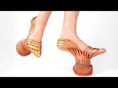 """Israeli designer Neta Soreq 3D printed the springy platforms and heels of these shoes to give the wearer a """"new walking experience"""". The Energetic Pass footwear comes in two variations: one pair has a bouncy platform beneath the centre of the foot, and the other features springs under the front and back. Both models surround the feet with sinuous stripes of material based on muscle fibres."""