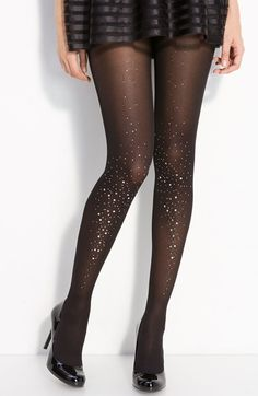 A spray of jewels add party-perfect sparkle to the front of sheer tights.