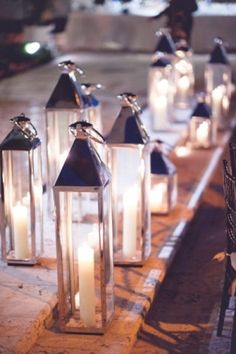 Tall, thin lanterns. These would be gorgeous as part of a centerpiece.